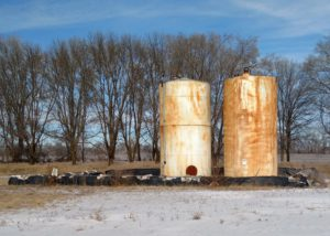 Bulk Fuel Storage With Hay Bale Secondary Containment Observed During SPCC Audit