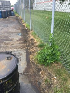 This photo shows an example of Leaking Waste Solvent Drums contaminating soil and groundwater near the property line